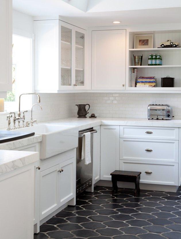 Spanish style bungalow white kitchen dark floors