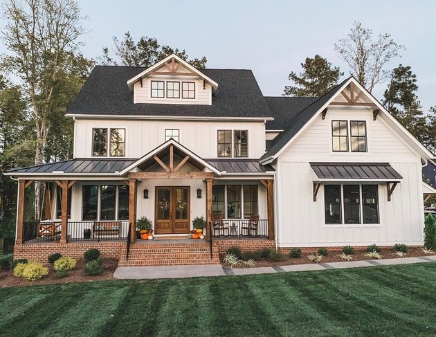 farmhouse exterior with black and white paint and brick steps