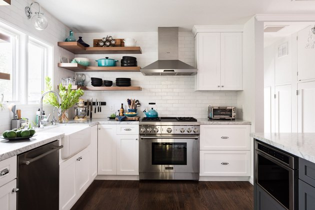 Dark wood kitchen flooring idea with white cabinets and open shelves