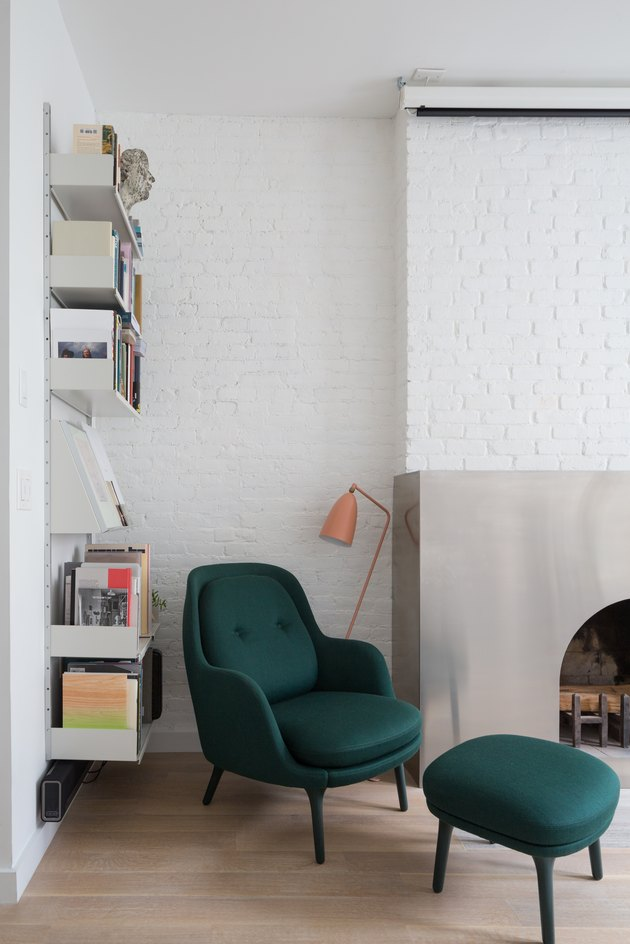 living room with white painted brick