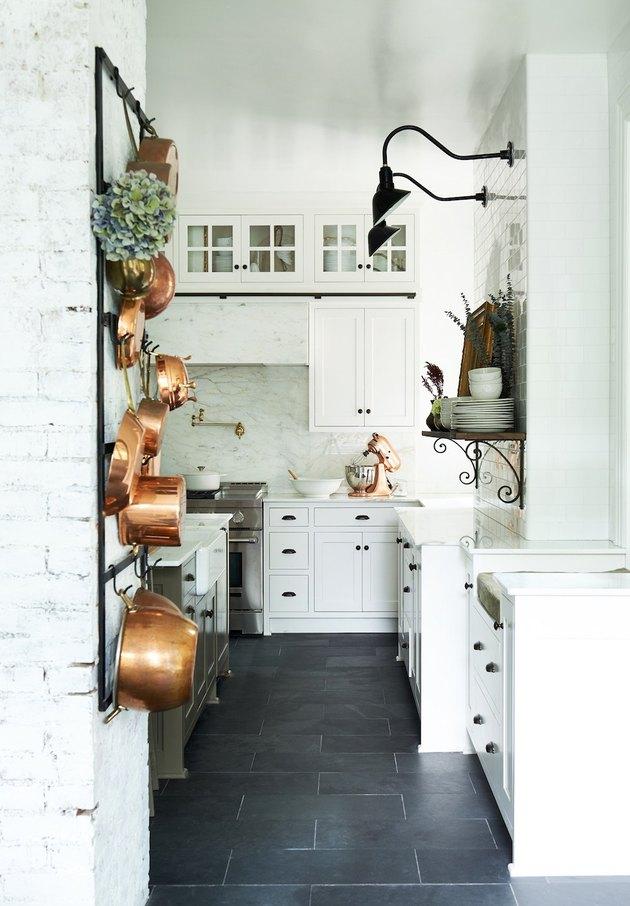 white kitchen dark floors with black hardware and dark floors and copper decor
