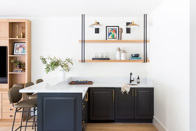 Blue cabinets with white countertop under open shelving
