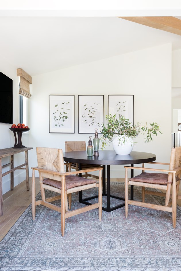 A breakfast nook with woven chairs