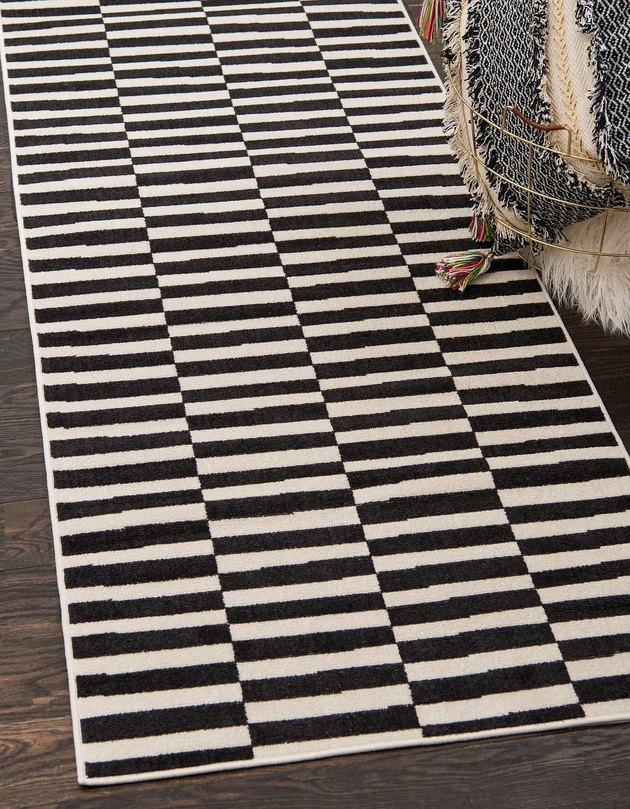 Black and white striped rug with stripes in different columns