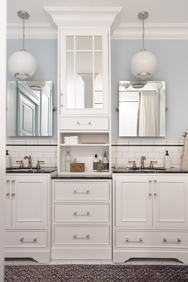 Double bathroom vanity with white cabinets and globe pendant lights