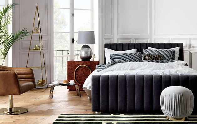 chic bedroom with navy bed frame