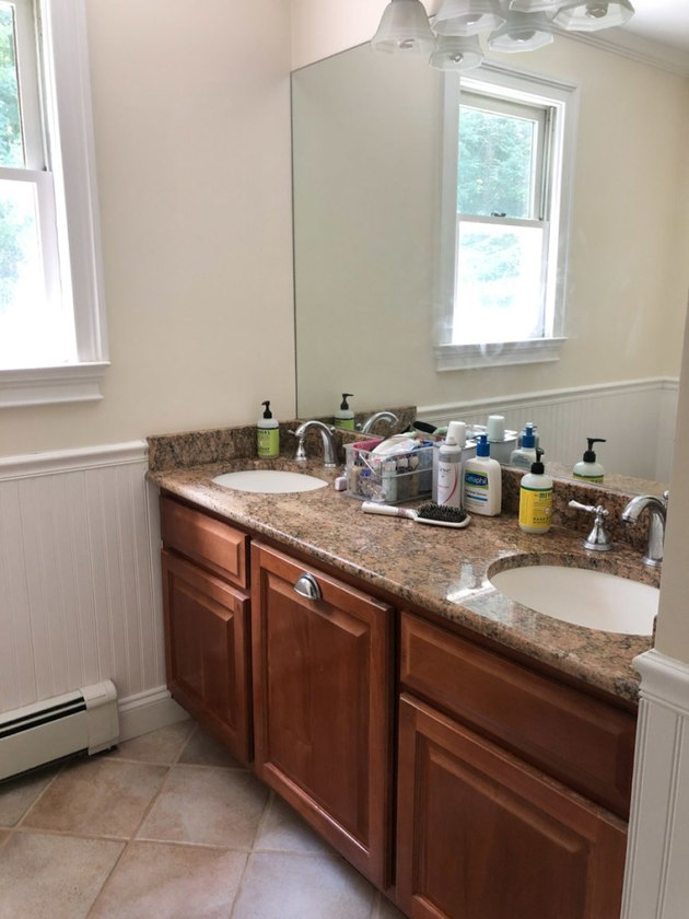 Painted bathroom cabinets before and after featuring dark wood cabinets and large mirror