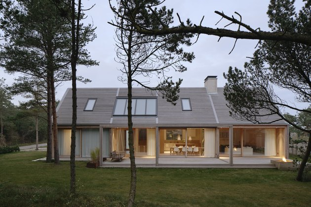 Scandinavian style house seem from the outside with trees nearby