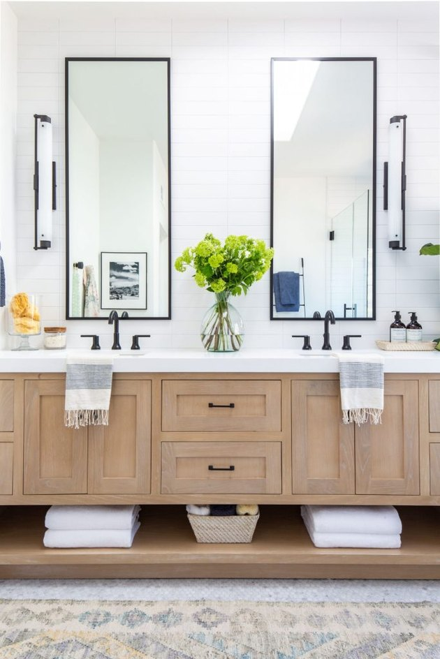 Double bathroom vanity with rectangular mirrors and wood cabinets