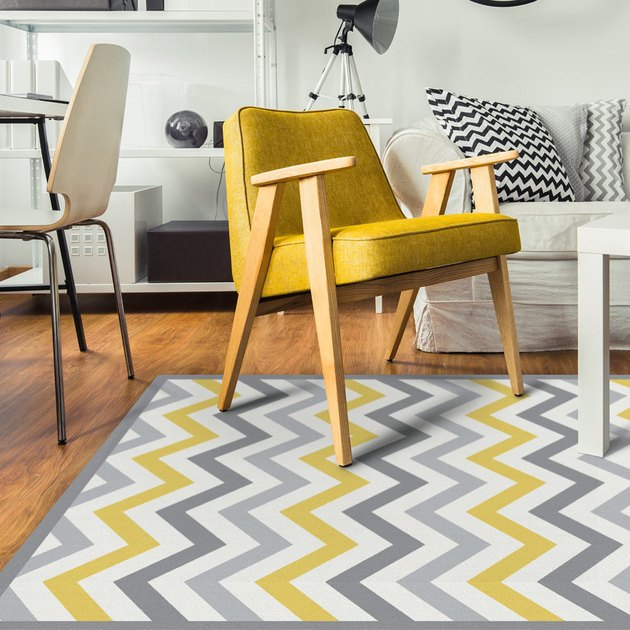 living room space with yellow and gray chevron pattern rug and yellow chair