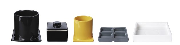 five serving dishes in black, yellow, gray and white