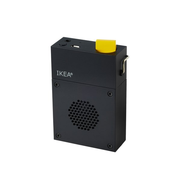 black portable speaker with yellow switch