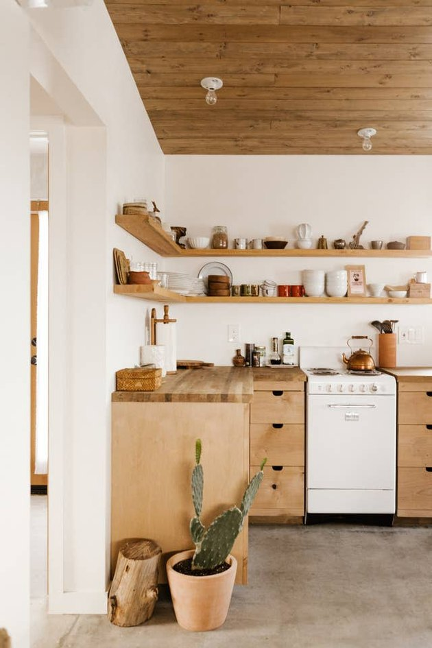 Desert-Themed Kitchen with wood cabinets and open shelving