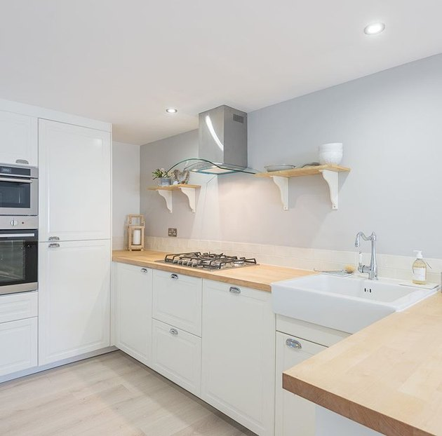 kitchen space with white cabinets and light hardwood floor