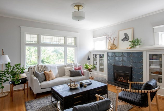 Craftsman living room with modern tiled fireplace