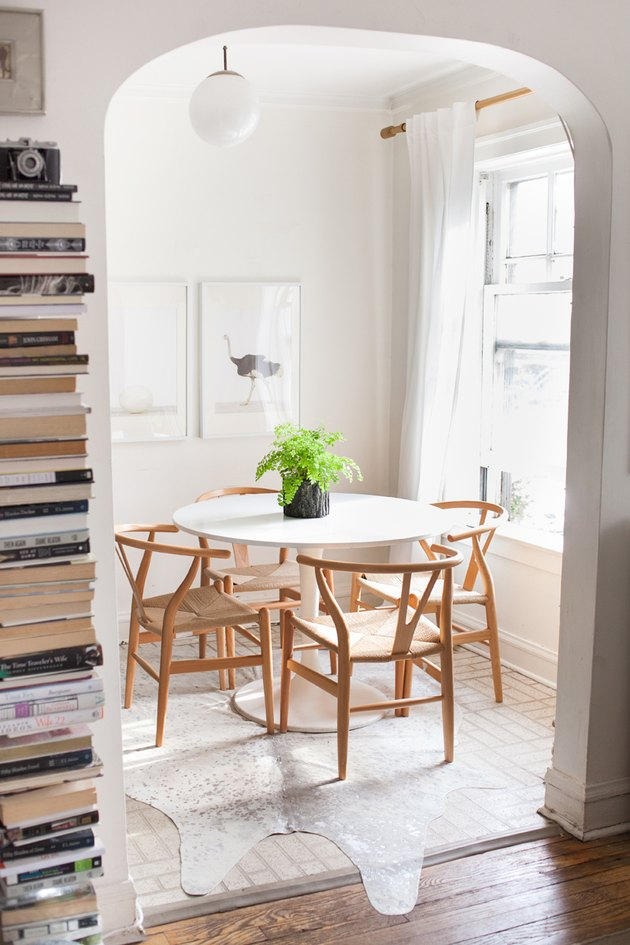 ivory cowhide rug for kitchen floor in eat-in kitchen with tulip table and wishbone chairs