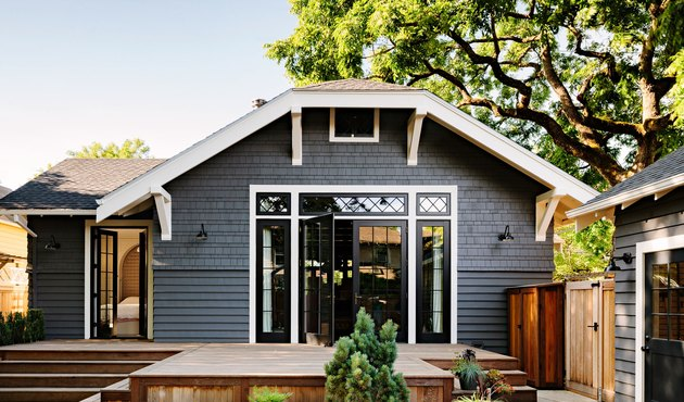 gray bungalow with glass Craftsman-style doors