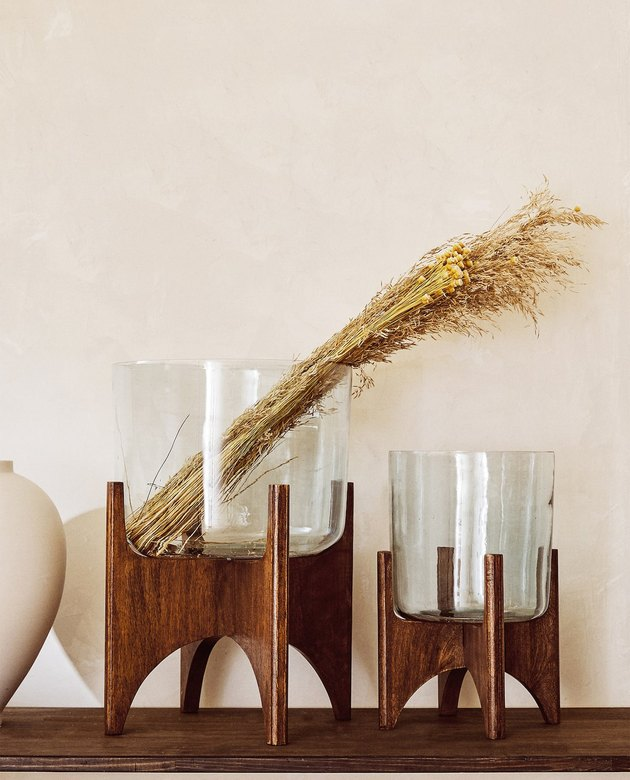 glass and wood flower pots with wheat