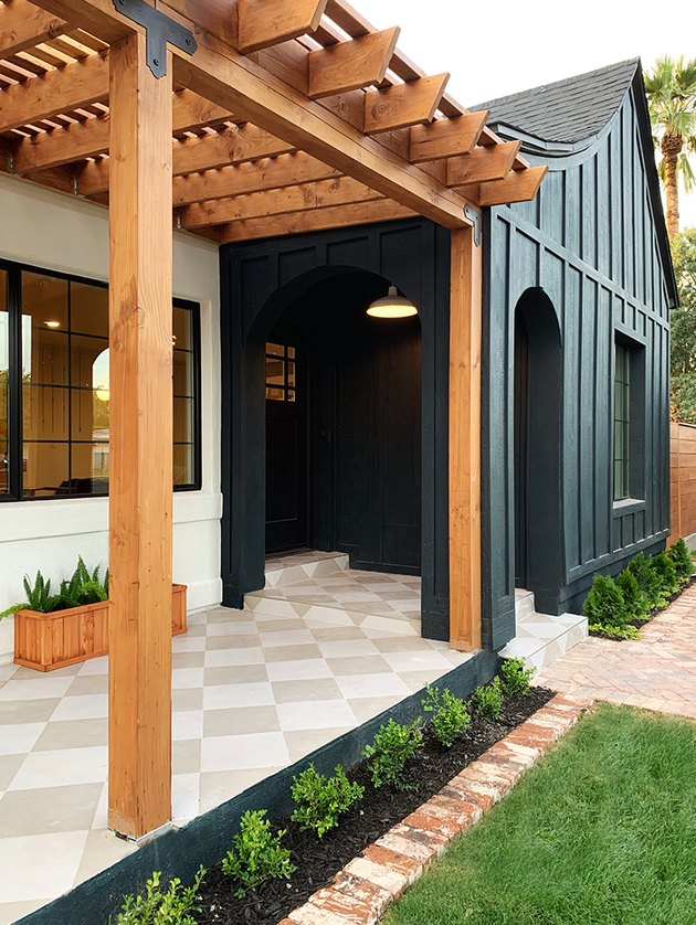 Craftsman front porch in modern styling with pergola and black exterior