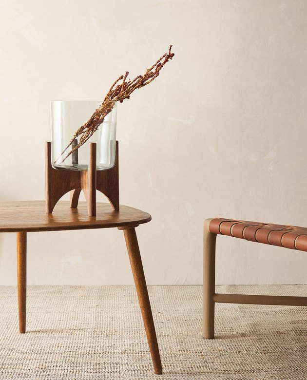 glass and wood planter on a wood table