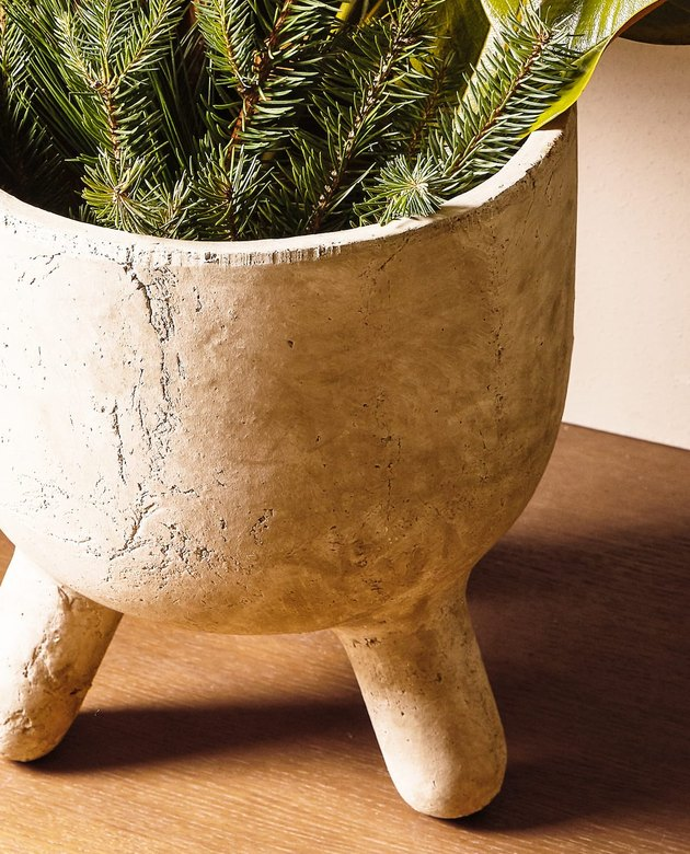 earthenware pot stand with evergreen branches