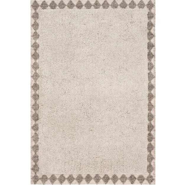 Cream Scandinavian rug with graphic border