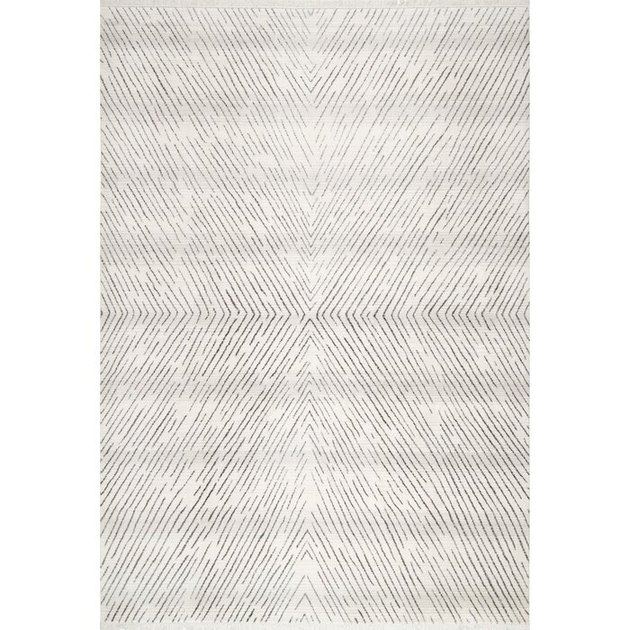 Black and white Scandinavian rug with subtle linear design