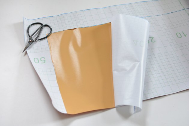 plastic backing on contact paper being removed