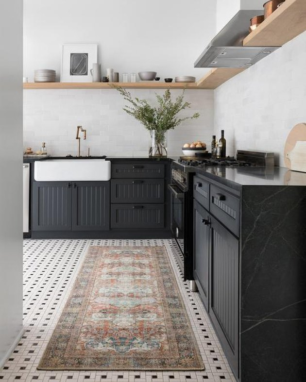 rug for kitchen floor with black cabinets and countertops
