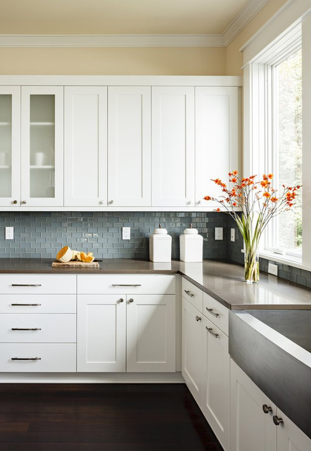 dark wood kitchen flooring idea with green tile backsplash and wood countertops