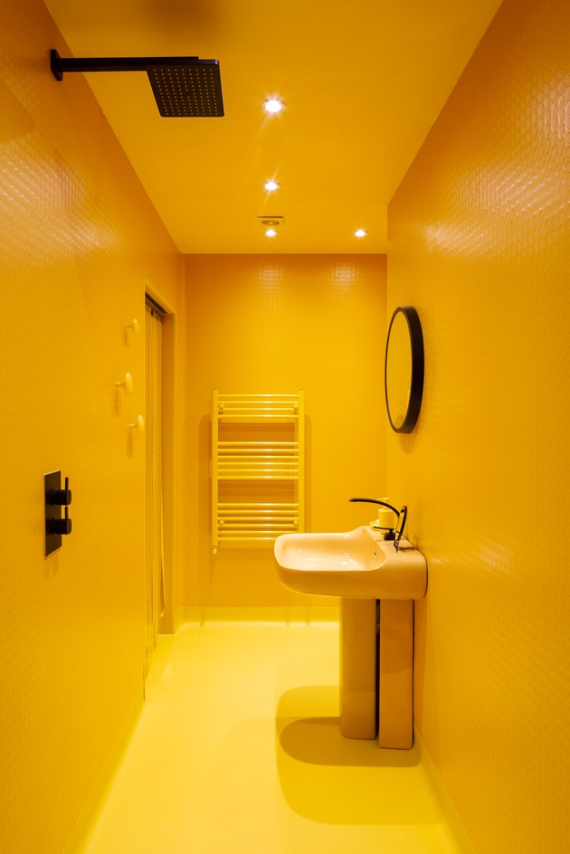 all over bright-yellow wet room in Margate, Unite Kingdom