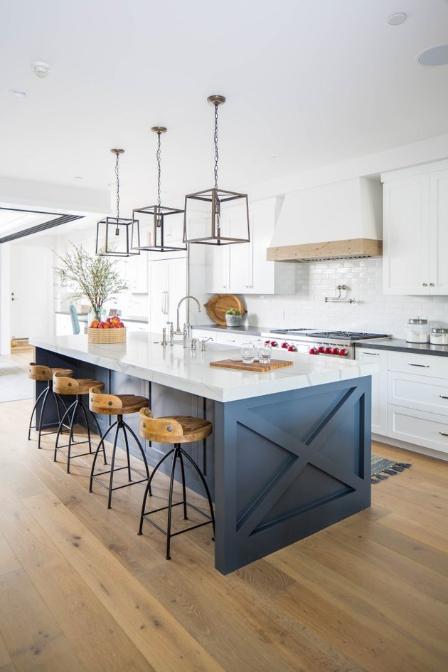 white industrial kitchen with dark island