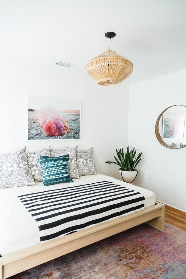 white Scandinavian boho bedroom with boho accents