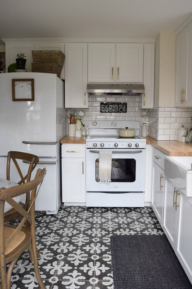 simple white kitchen with deco gray patterned tile