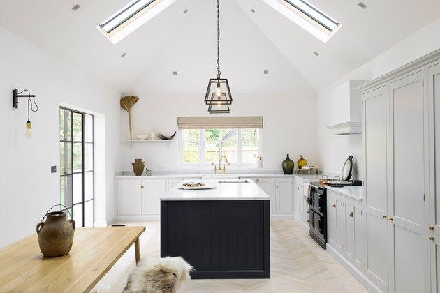 white kitchen with dark blue kitchen island