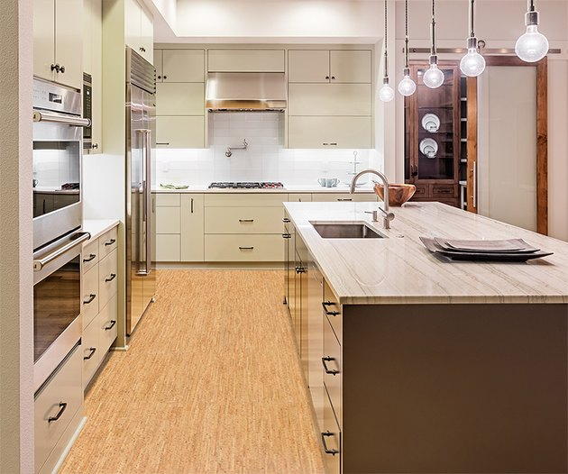 Cork flooring in contemporary kitchen with island and pendant lighting