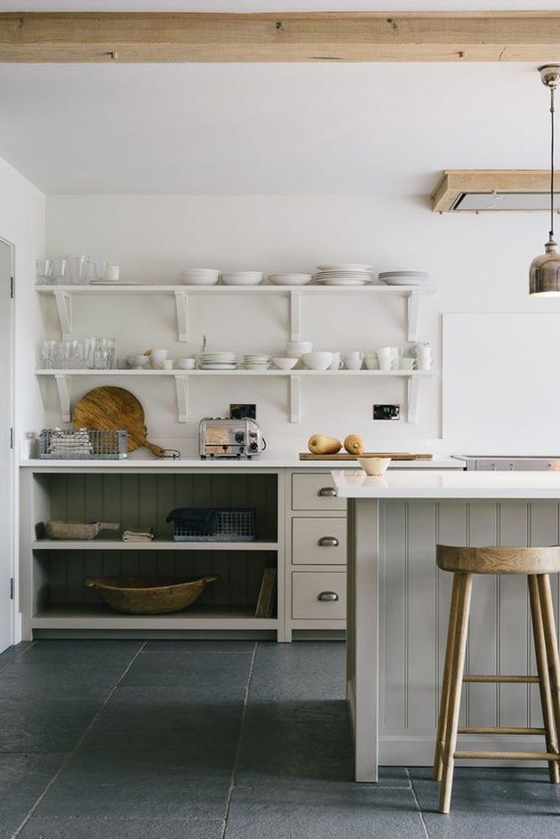 gray country farmhouse kitchen with limestone floor