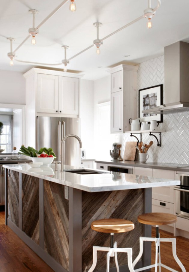 Gray kitchen island with reclaimed wood base and white counter.