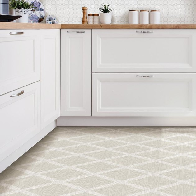 white kitchen cabinets with patterned cream floor