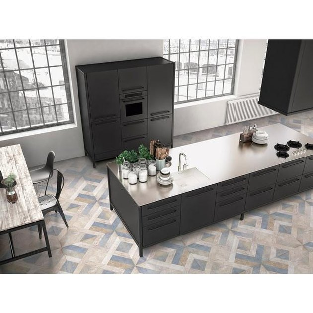 Patterned ceramic tile in modern kitchen with large island with charcoal-colored cabinets