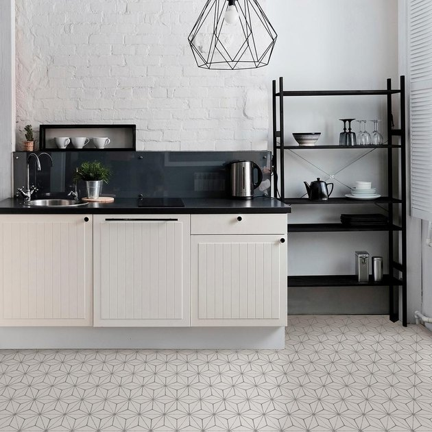 kitchen with geometric patterned floor and white cabinets