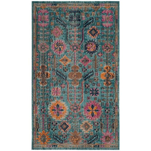 Colorful teal rug for bohemian living room