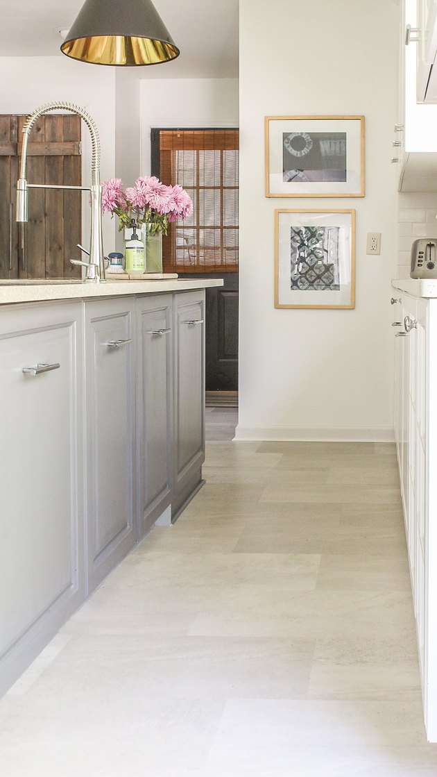 kitchen space with gray cabinets and vinyl cream flooring