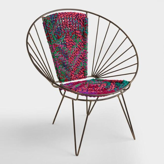 Metal chair with a woven patterned center for bohemian living room