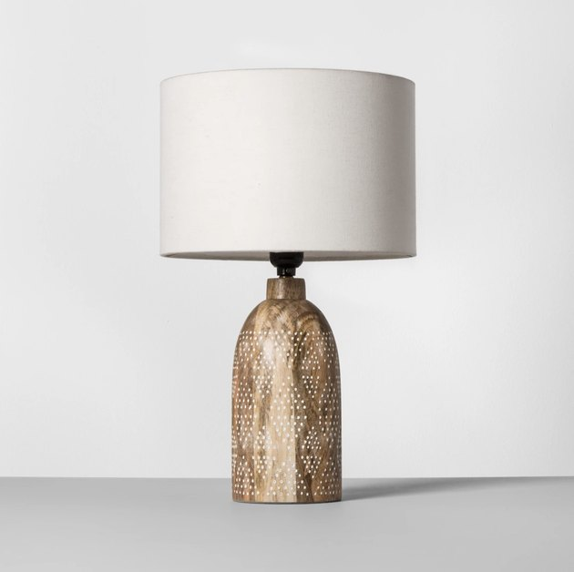 Table lamp with carved base for bohemian living room
