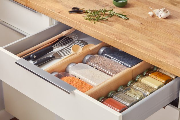 kitchen drawer showing utensils and spices