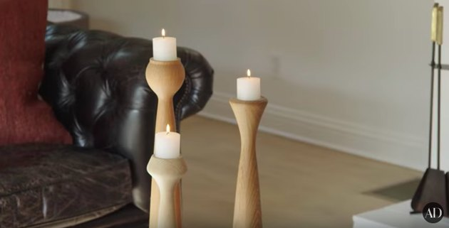 three wood candlesticks with white candles