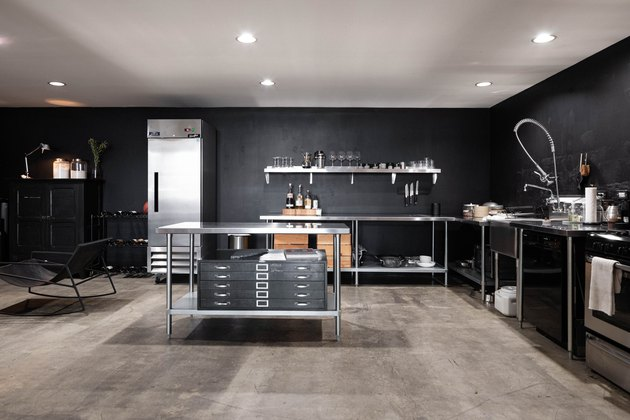 large kitchen with black walls and stainless steel cabinetry