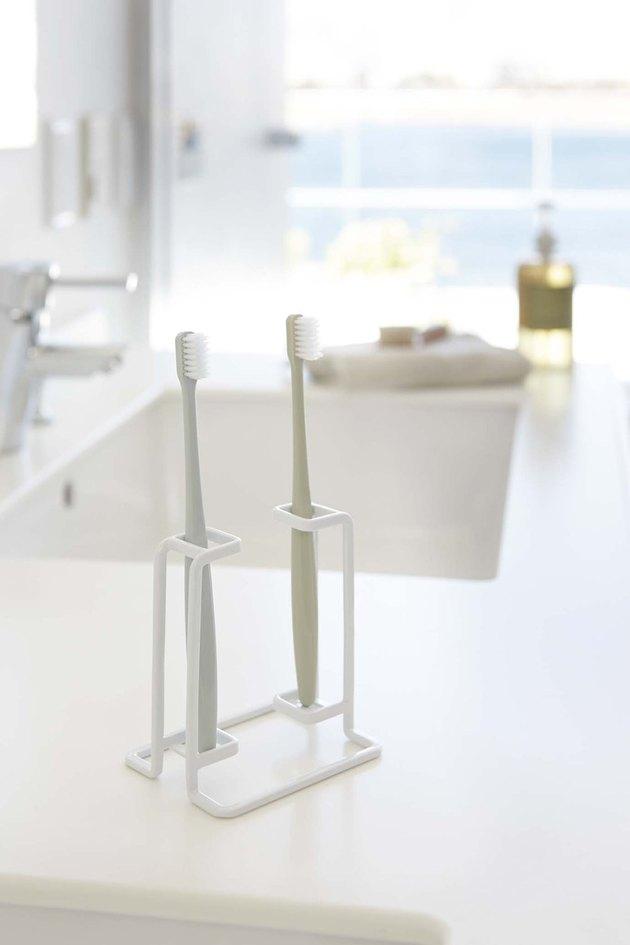 Minimalist white toothbrush stand