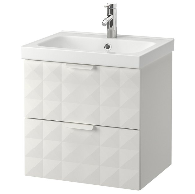 White small bathroom vanity with geometric details and sink